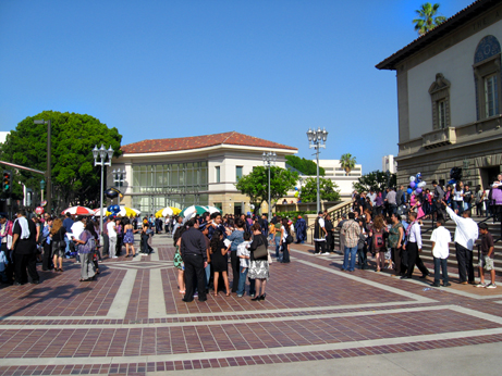Franklin High students gather on the plaza with family and friends celebrating their graduation